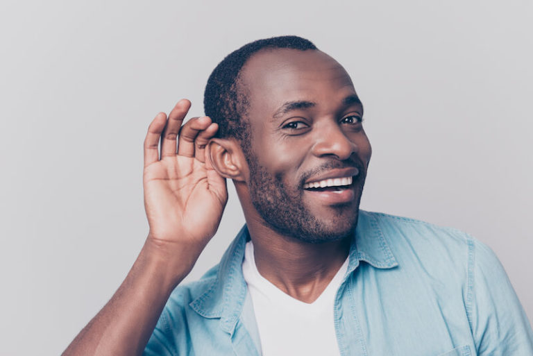 man listening with his ear