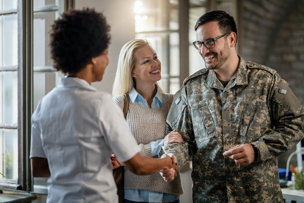 Military couple meeting with doctor about tinnitus
