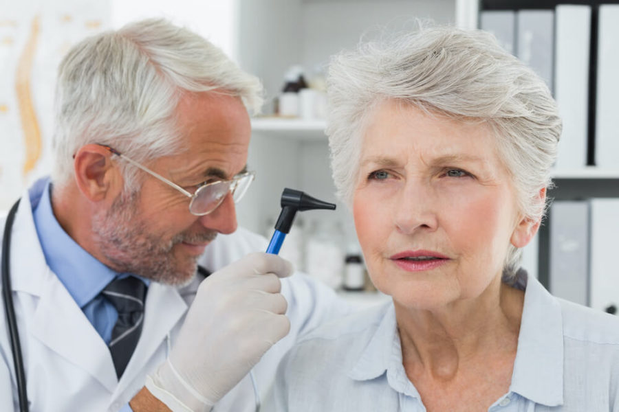doctor using otoscope for patient's ear