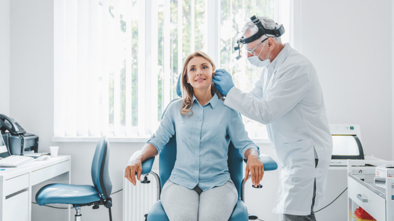 doctor checking a patients ear for sensorineural hearing loss