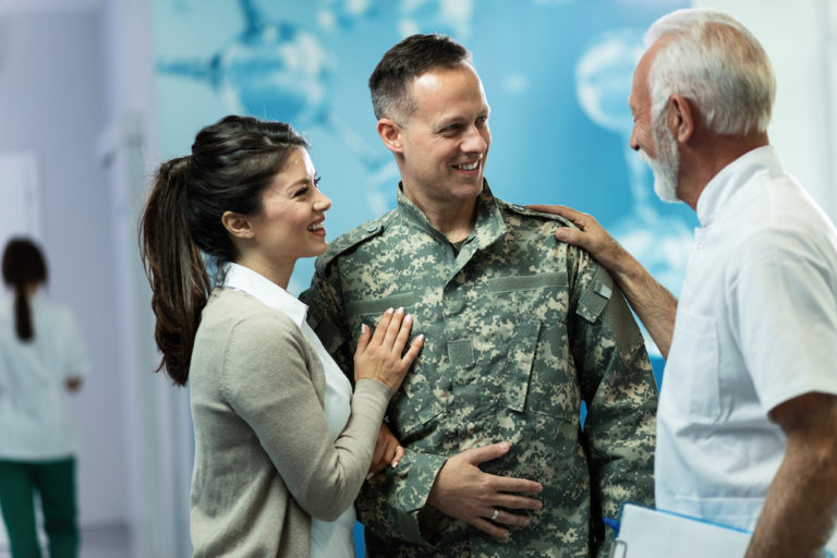 military veteran and wife meeting with doctor